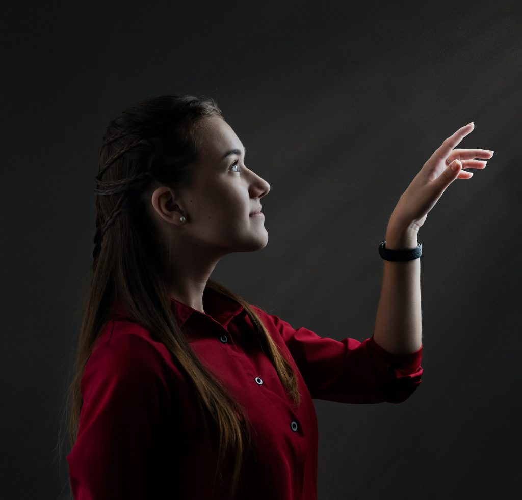 set goals within reach - woman pointing upwards